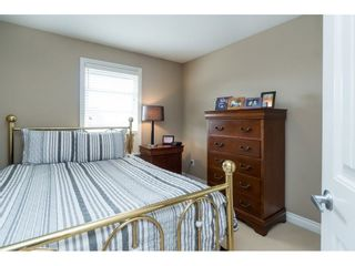 """Photo 13: 7033 179A Street in Surrey: Cloverdale BC Condo for sale in """"Provinceton"""" (Cloverdale)  : MLS®# R2392761"""