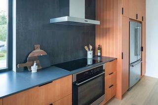Photo 12: 38703 GARIBALDI Avenue in Squamish: Northyards 1/2 Duplex for sale : MLS®# R2615289