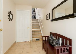Photo 3: 19 Coachway Green SW in Calgary: Coach Hill Row/Townhouse for sale : MLS®# A1118919
