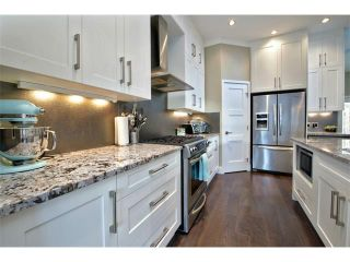 Photo 2: 931 33 Street NW in Calgary: Parkdale House for sale : MLS®# C4003919