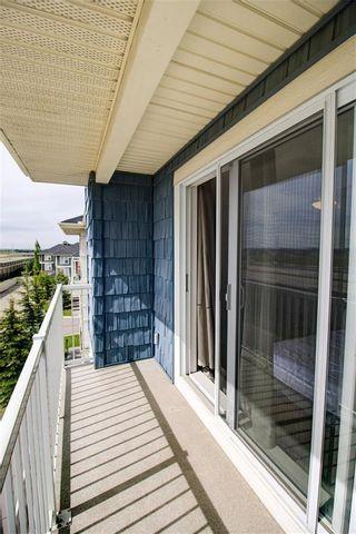 Photo 19: 50 Auburn Bay Common SE in Calgary: Auburn Bay Row/Townhouse for sale : MLS®# A1128928