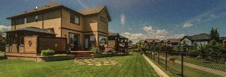 Photo 3: 36 Quarry Gardens SE in Calgary: Douglasdale/Glen Detached for sale : MLS®# A1074544