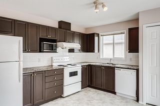 Photo 6: 6633 Pinecliff Grove NE in Calgary: Pineridge Row/Townhouse for sale : MLS®# A1128920