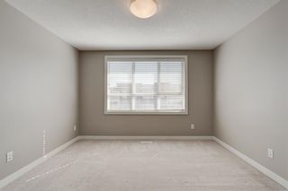 Photo 18: 103 Walgrove Cove SE in Calgary: Walden Row/Townhouse for sale : MLS®# A1145152
