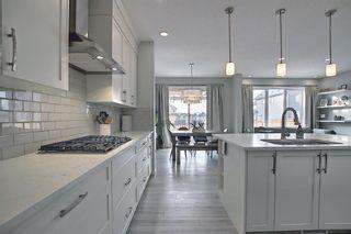 Photo 8: 28 Sundown Avenue: Cochrane Detached for sale : MLS®# A1071788
