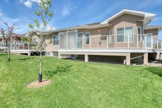 Photo 45: 64 RIVER HEIGHTS View: Cochrane Semi Detached for sale : MLS®# C4300497
