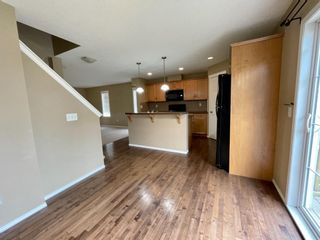 Photo 6: 32 Country Village Lane NE in Calgary: Country Hills Village Row/Townhouse for sale : MLS®# A1115635