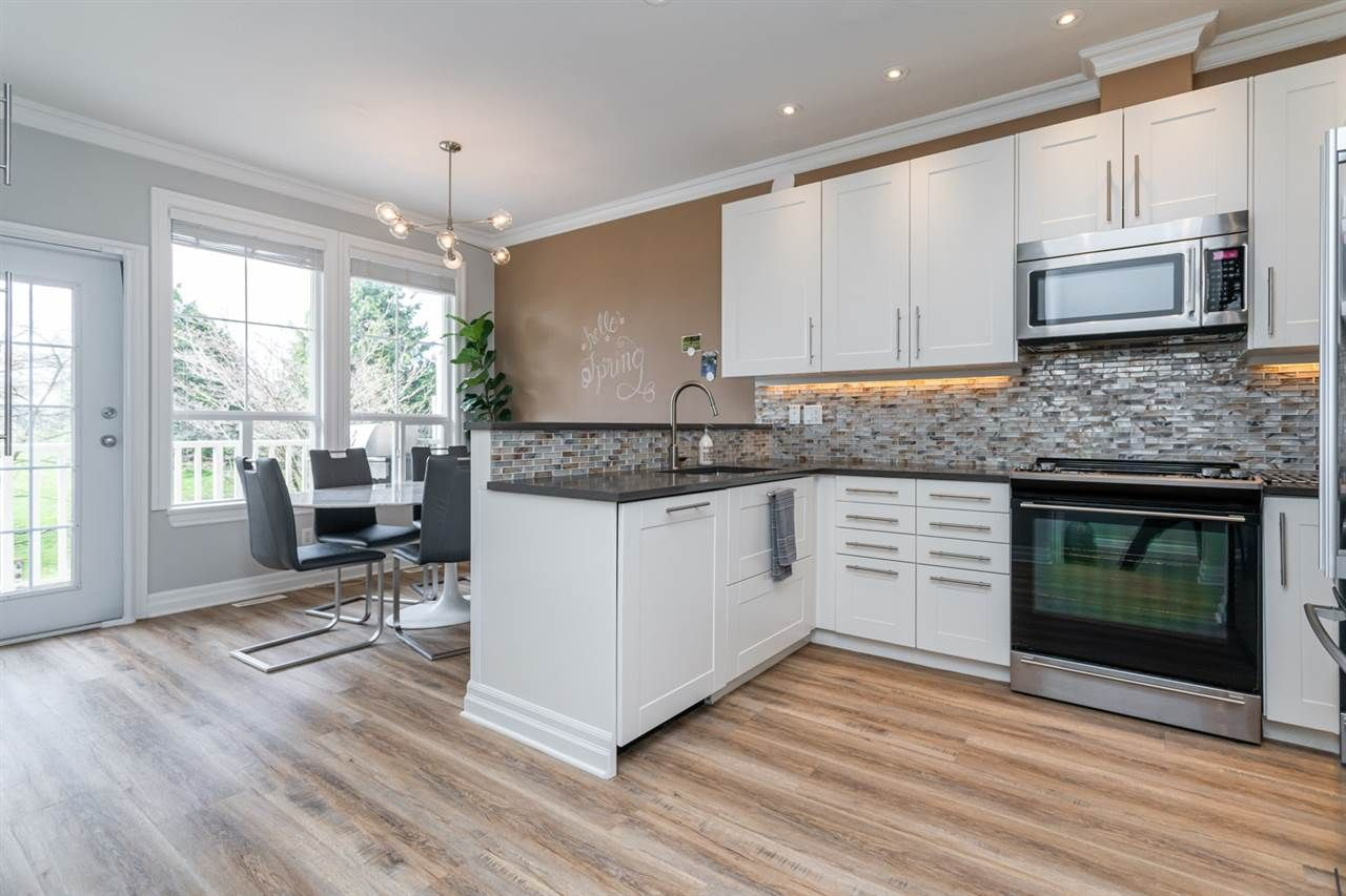 """Main Photo: 55 14952 58 Avenue in Surrey: Sullivan Station Townhouse for sale in """"Highbrae"""" : MLS®# R2561651"""