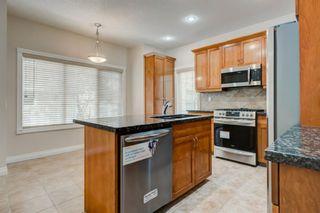 Photo 7: 4111 Garrison Boulevard SW in Calgary: Garrison Woods Row/Townhouse for sale : MLS®# A1108505