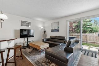 Photo 3: 102 4810 40 Avenue SW in Calgary: Glamorgan Row/Townhouse for sale : MLS®# A1136264