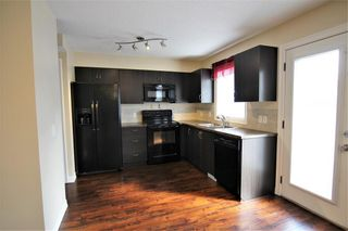 Photo 4: 157 Copperpond Heights SE in Calgary: Copperfield Row/Townhouse for sale : MLS®# A1090874
