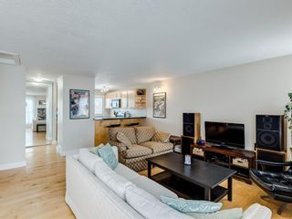 Photo 4: 248 54 Glamis Green SW in Calgary: Glamorgan Row/Townhouse for sale : MLS®# A1069840