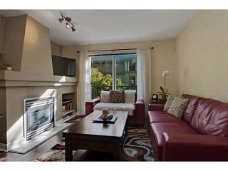 """Photo 5: 84 1561 BOOTH Avenue in Coquitlam: Maillardville Townhouse for sale in """"THE COURCELLES"""" : MLS®# V1087510"""
