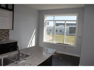 Photo 15: 700 Ranch Crescent: Carstairs Detached for sale : MLS®# A1118521