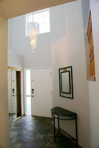 Photo 4: 111 Somercrest Gardens SW in Calgary: Somerset Detached for sale : MLS®# A1147162