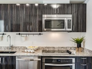 Photo 9: 801 450 8 Avenue SE in Calgary: Downtown East Village Apartment for sale : MLS®# A1071228