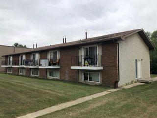 Photo 2: 555 9 Avenue SW: High River Multi Family for sale : MLS®# A1136221