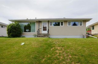 Photo 2: 2427 37 Street SW in Calgary: Glendale Detached for sale : MLS®# C4201043