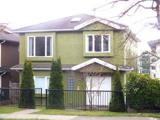 Photo 1: 3048 E 8TH Avenue in Vancouver: Renfrew VE House for sale (Vancouver East)  : MLS®# R2250637