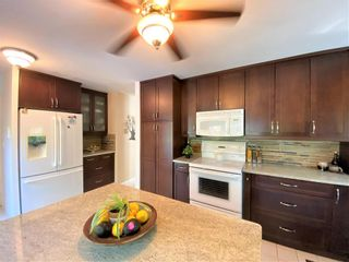 Photo 12: 518 Charleswood Road in Winnipeg: Charleswood Residential for sale (1G)  : MLS®# 202120289