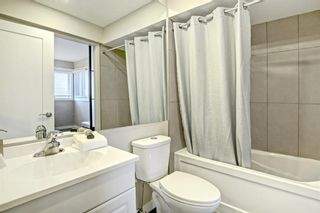 Photo 26: 14 Glamis Gardens SW in Calgary: Glamorgan Row/Townhouse for sale : MLS®# A1076786