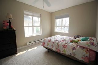 """Photo 12: 18610 65 Avenue in Surrey: Cloverdale BC Townhouse for sale in """"Ridgeway"""" (Cloverdale)  : MLS®# R2299055"""