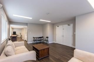 """Photo 33: 107 5909 177B Street in Surrey: Cloverdale BC Condo for sale in """"Carridge Court"""" (Cloverdale)  : MLS®# R2602969"""