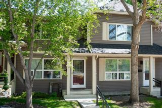 Photo 3: 332 Queenston Heights SE in Calgary: Queensland Row/Townhouse for sale : MLS®# A1114442