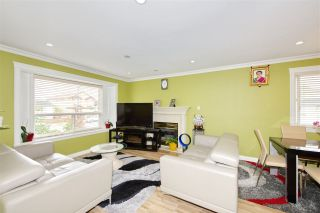 Photo 1: 7480 MAIN Street in Vancouver: South Vancouver House for sale (Vancouver East)  : MLS®# R2393431