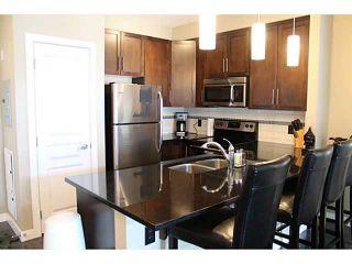 Photo 3: 209 22 PANATELLA Road NW in : Panorama Hills Condo for sale (Calgary)  : MLS®# C3586626