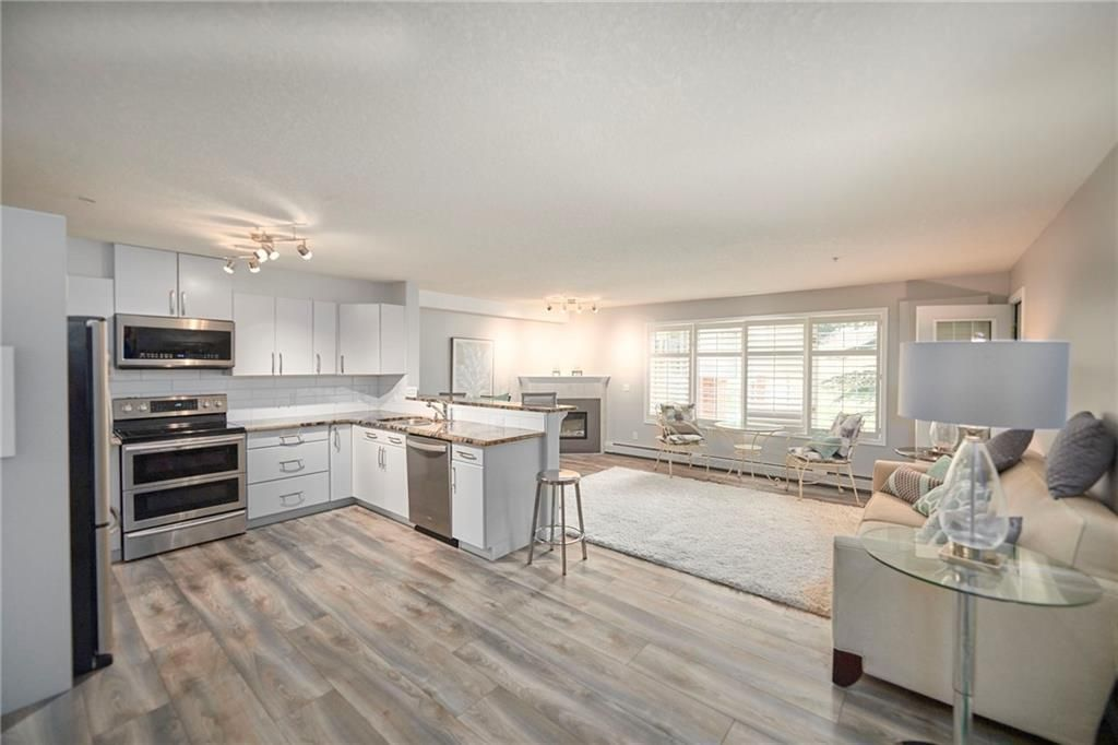 Main Photo: 117 6868 Sierra Morena Boulevard SW in Calgary: Signal Hill Apartment for sale : MLS®# A1122114