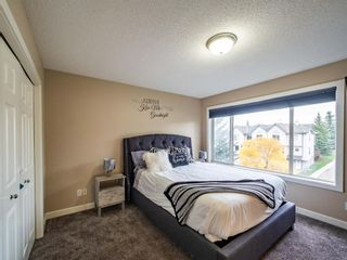 Photo 15: 27 Sandarac Road NW in Calgary: Sandstone Valley Row/Townhouse for sale : MLS®# A1148451