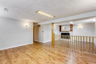 Photo 12: 131 Huntridge Road NE in Calgary: Huntington Hills Detached for sale : MLS®# A1117204