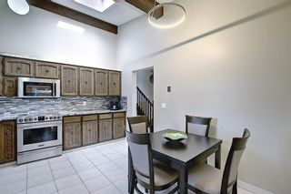 Photo 10: 335 Queensland Place SE in Calgary: Queensland Detached for sale : MLS®# A1137041
