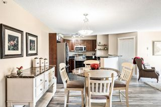 Photo 3: 7410 304 Mackenzie Way SW: Airdrie Apartment for sale : MLS®# A1149163