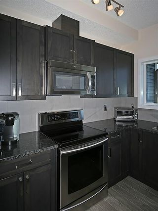 Photo 4: 451 HILLCREST Circle SW: Airdrie House for sale