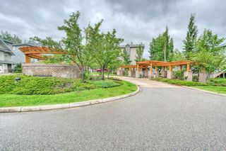 Photo 2: 66 Crystal Shores Cove: Okotoks Row/Townhouse for sale : MLS®# C4305435