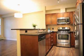 Photo 1: 108 48 Panatella Road NW in Calgary: Panorama Hills Apartment for sale : MLS®# A1063178