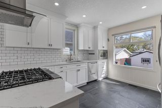 Photo 4: 219 15 Avenue NE in Calgary: Crescent Heights Detached for sale : MLS®# A1111054