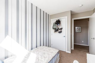 Photo 18: 1001 218 Sherwood Square NW in Calgary: Sherwood Row/Townhouse for sale : MLS®# A1147454