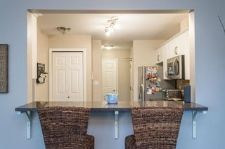 """Photo 7: 107 5909 177B Street in Surrey: Cloverdale BC Condo for sale in """"Carridge Court"""" (Cloverdale)  : MLS®# R2602969"""