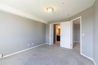 Photo 17: 8329 304 MACKENZIE Way SW: Airdrie Apartment for sale : MLS®# A1128736