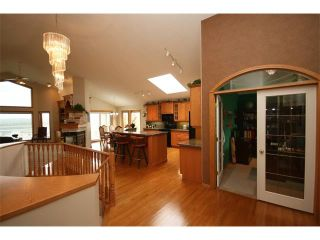 Photo 5: 315 GLENEAGLES View: Cochrane House for sale : MLS®# C4014401