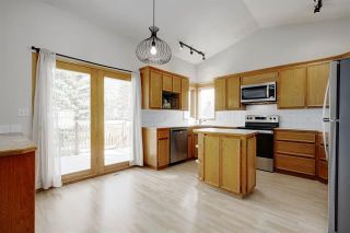 Photo 12: 24 SIGNATURE Way SW in Calgary: Signal Hill Detached for sale : MLS®# C4302567