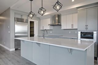 Photo 5: 317 15 Cougar Ridge Landing SW in Calgary: Patterson Apartment for sale : MLS®# A1121388