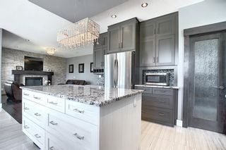Photo 16: 105 KINNIBURGH Bay: Chestermere Detached for sale : MLS®# A1116532