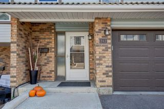 Photo 2: 212 Coachway Lane SW in Calgary: Coach Hill Row/Townhouse for sale : MLS®# A1153091