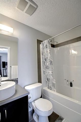 Photo 33: 1103 125 Panatella Way NW in Calgary: Panorama Hills Row/Townhouse for sale : MLS®# A1143179