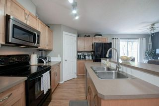 Photo 11: 79 Country Village Gate NE in Calgary: Country Hills Village Row/Townhouse for sale : MLS®# A1125396