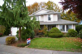 Photo 1: 6970 COACH LAMP Drive in Sardis: Sardis West Vedder Rd House for sale : MLS®# R2118745